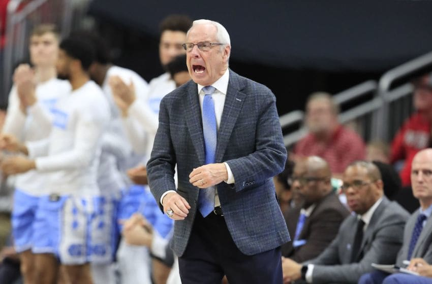 LOUISVILLE, KENTUCKY - FEBRUARY 22: Roy Williams the head coach of the North Carolina Tar Heels gives instructions to his team against the Louisville Cardinals at KFC YUM! Center on February 22, 2020 in Louisville, Kentucky. (Photo by Andy Lyons/Getty Images)