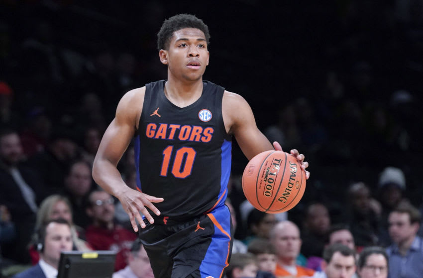 BROOKLYN, NY - DECEMBER 17: Noah Locke #10 of the Florida Gators dribbles the ball against the Providence Friars during the Basketball Hall of Fame Invitational at the Barclays Center on December 17, 2019 in the Brooklyn borough of New York City. (Photo by Porter Binks/Getty Images)