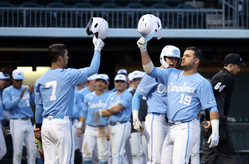 CHAPEL HILL, NC - FEBRUARY 19: Aaron Sabato #19 of the University of North Carolina celebrates his home run with teammate Dallas Tessar #7 during a game between High Point and North Carolina at Boshamer Stadium on February 19, 2020 in Chapel Hill, North Carolina. (Photo by Andy Mead/ISI Photos/Getty Images)