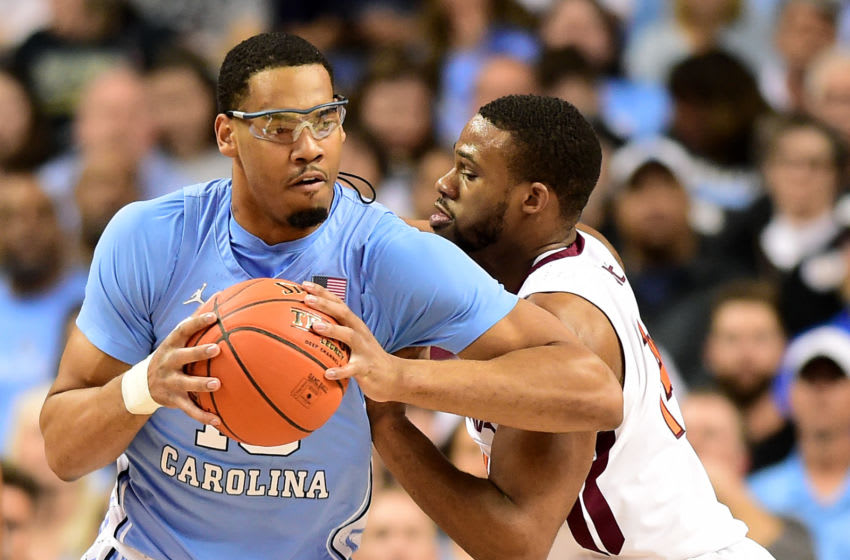 GREENSBORO, NORTH CAROLINA - MARCH 10: Garrison Brooks #15 of the North Carolina Tar Heels plays the post against P.J. Horne #14 of the Virginia Tech Hokies during their game in the first round of the 2020 Men's ACC Basketball Tournament at Greensboro Coliseum on March 10, 2020 in Greensboro, North Carolina. (Photo by Jared C. Tilton/Getty Images)