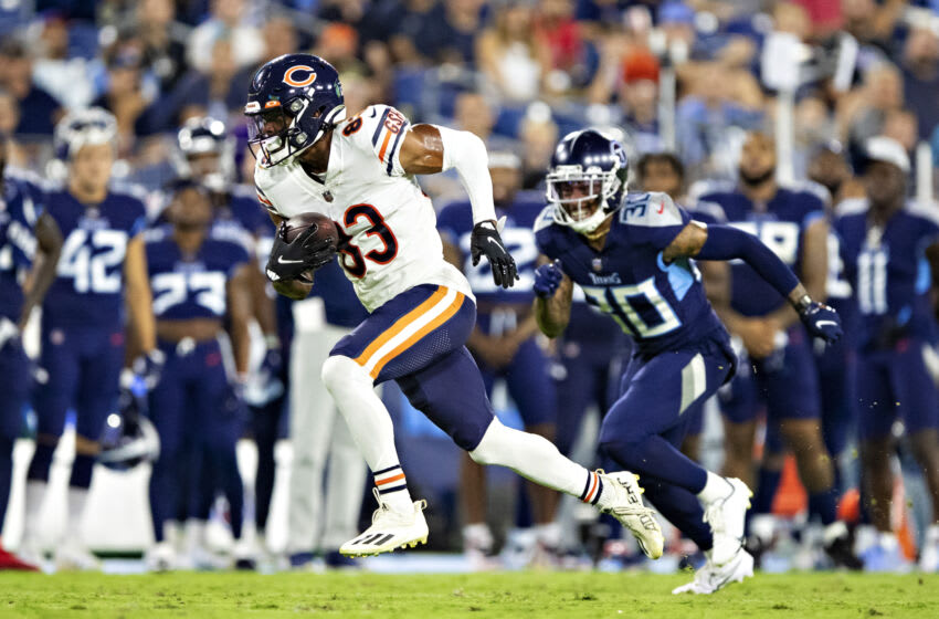 NASHVILLE, TN - AUGUST 28: Dazz Newsome #83 of the Chicago Bears runs the ball and is chased by Bradley McDougald #30 of the Tennessee Titans during an NFL preseason game at Nissan Stadium on August 28, 2021 in Nashville, Tennessee. The Bears defeated the Titans 27-24. (Photo by Wesley Hitt/Getty Images)