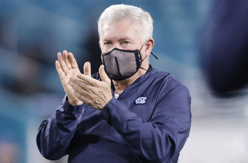MIAMI GARDENS, FLORIDA - JANUARY 02: Head coach Mack Brown of the North Carolina Tar Heels looks on prior to the Capital One Orange Bowl against the Texas A&M Aggies at Hard Rock Stadium on January 02, 2021 in Miami Gardens, Florida. (Photo by Michael Reaves/Getty Images)