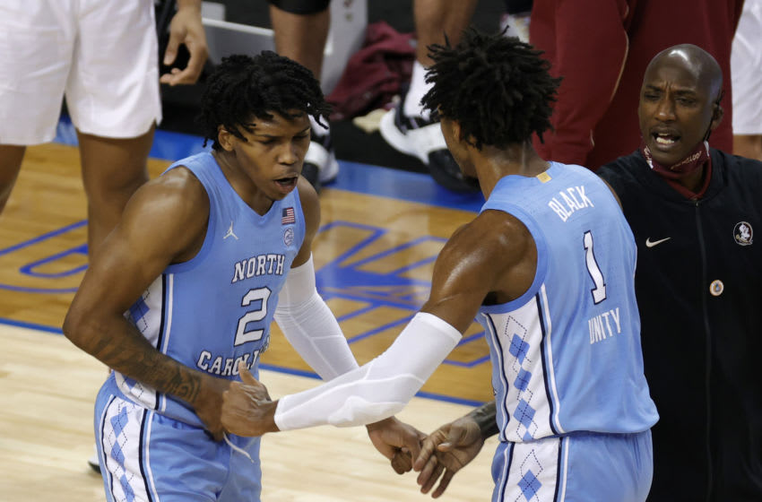 GREENSBORO, NORTH CAROLINA - MARCH 12: Caleb Love #2 of the North Carolina Tar Heels celebrates with teammate Leaky Black #1 during the second half of their semifinals game in the ACC Men's Basketball Tournament at Greensboro Coliseum on March 12, 2021 in Greensboro, North Carolina. (Photo by Jared C. Tilton/Getty Images)