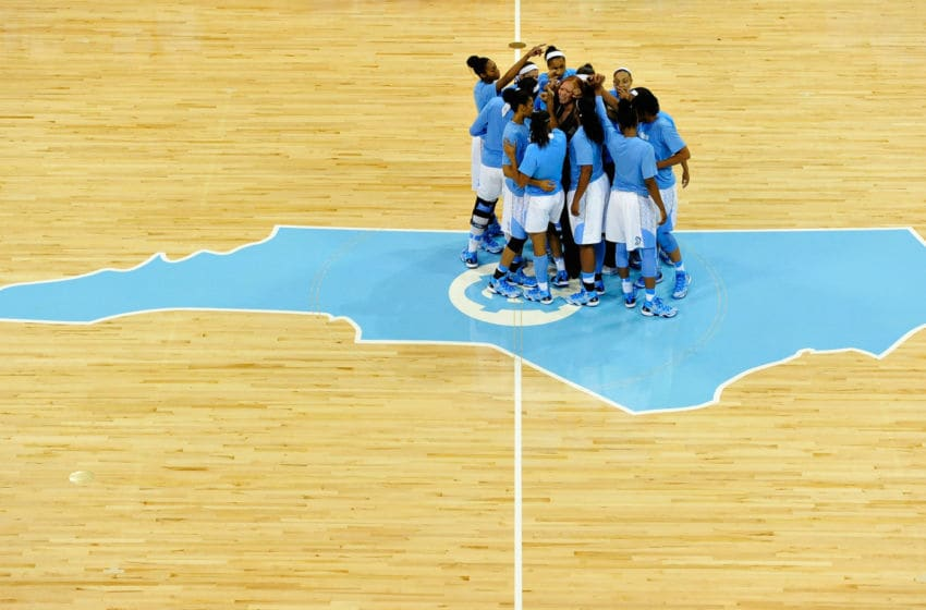 CHAPEL HILL, NC - NOVEMBER 11: The North Carolina Tar Heels huddle before a game against the Tennessee Lady Vols at Carmichael Arena on November 11, 2013 in Chapel Hill, North Carolina. Tennessee won 81-65. (Photo by Grant Halverson/Getty Images)