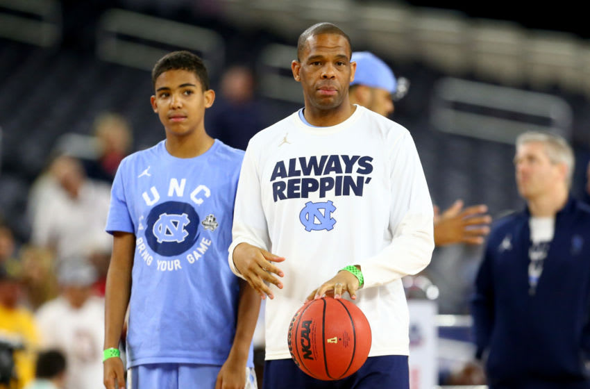 HOUSTON, TEXAS - APRIL 01: Assistant coach Hubert Davis of the North Carolina Tar Heels looks on with his son Elijah during a practice session for the 2016 NCAA Men's Final Four at NRG Stadium on April 1, 2016 in Houston, Texas. (Photo by Ronald Martinez/Getty Images)