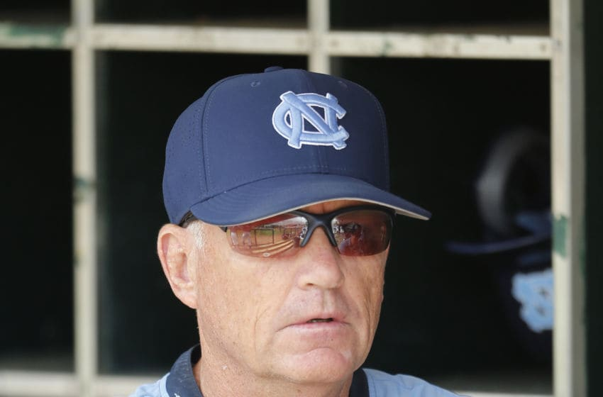 CORAL GABLES, FL - APRIL 3: Head coach Mike Fox of the North Carolina Tar Heels watches the Miami Hurricanes warm up prior to their game on April 3, 2016 at Alex Rodriguez Park at Mark Light Field in Coral Gables, Florida. Miami defeated North Carolina 7-4. (Photo by Joel Auerbach/Getty Images)