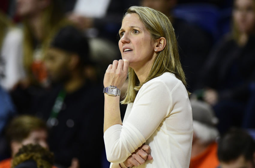 PHILADELPHIA, PA - MARCH 11: Head coach Courtney Banghart of the Princeton Tigers looks on against the Harvard Crimson during the third quarter of an Ivy League semifinal matchup at The Palestra on March 11, 2017 in Philadelphia, Pennsylvania. Princeton won 68-47. (Photo by Corey Perrine/Getty Images)