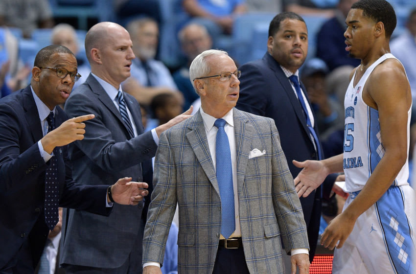 CHAPEL HILL, NC - DECEMBER 03: (L-R) Hubert Davis, Brad Fredrick, head coach Roy Williams and Garrison Brooks #15 of the North Carolina Tar Heels during their game against the Tulane Green Wave at the Dean Smith Center on December 3, 2017 in Chapel Hill, North Carolina. North Carolina won 97-73. (Photo by Grant Halverson/Getty Images)