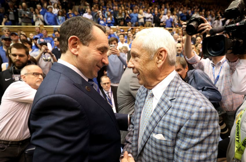 DURHAM, NC - MARCH 03: (L-R) Head coach Mike Krzyzewski of the Duke Blue Devils talks to head coach Roy Williams of the North Carolina Tar Heels before their game at Cameron Indoor Stadium on March 3, 2018 in Durham, North Carolina. (Photo by Streeter Lecka/Getty Images)