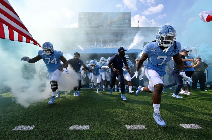 CHAPEL HILL, NORTH CAROLINA - SEPTEMBER 21: North Carolina Tar Heels players take the field during their game against the Appalachian State Mountaineers at Kenan Stadium on September 21, 2019 in Chapel Hill, North Carolina. The Mountaineers won 34-31. (Photo by Grant Halverson/Getty Images)