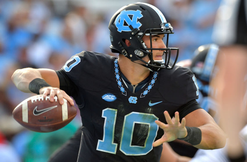 CHAPEL HILL, NC - NOVEMBER 25: Mitch Trubisky #10 of the North Carolina Tar Heels against the North Carolina State Wolfpack during their game at Kenan Stadium on November 25, 2016 in Chapel Hill, North Carolina. North Carolina State won 28-21. (Photo by Grant Halverson/Getty Images)