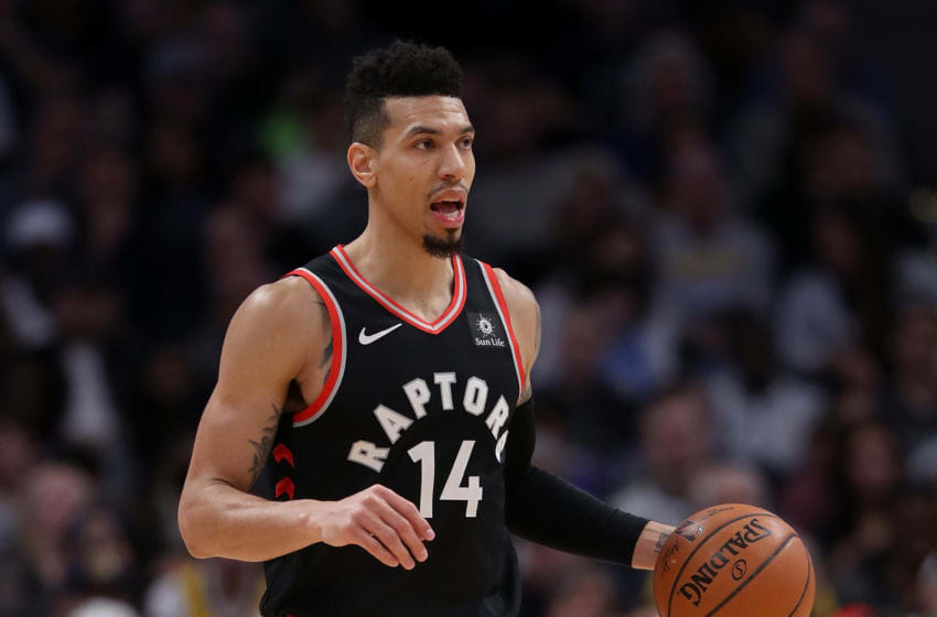 DENVER, COLORADO - DECEMBER 16: Danny Green #14 of the Toronto Raptors plays the Denver Nuggets at the Pepsi Center on December 16, 2018 in Denver, Colorado. (Photo by Matthew Stockman/Getty Images)