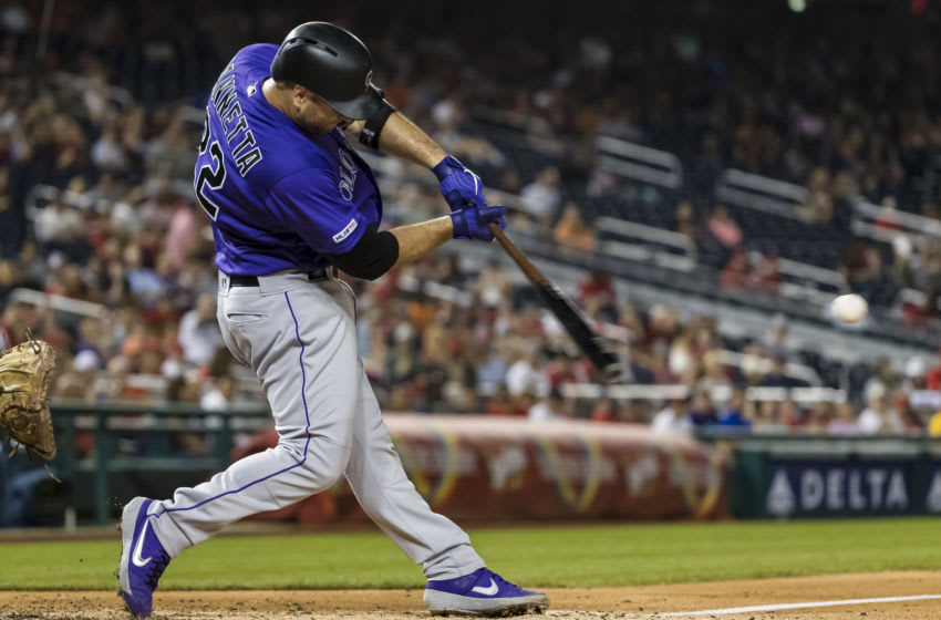 WASHINGTON, DC - JULY 24: Chris Iannetta #22 of the Colorado Rockies at bat against the Washington Nationals during the second inning of game two of a doubleheader at Nationals Park on June 24, 2019 in Washington, DC. (Photo by Scott Taetsch/Getty Images)