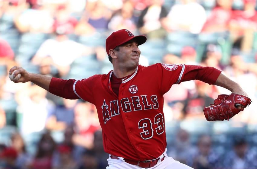 ANAHEIM, CALIFORNIA - JULY 13: Pitcher Matt Harvey #33 of the Los Angeles Angels of Anaheim pitches in the first innning of the MLB game against the Seattle Mariners at Angel Stadium of Anaheim on July 13, 2019 in Anaheim, California. (Photo by Victor Decolongon/Getty Images)
