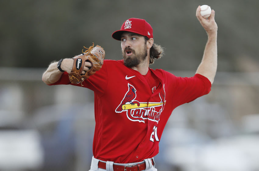 JUPITER, FLORIDA - FEBRUARY 19: Andrew Miller #21 of the St. Louis Cardinals throws a pitch during a team workout at Roger Dean Chevrolet Stadium on February 19, 2020 in Jupiter, Florida. (Photo by Michael Reaves/Getty Images)