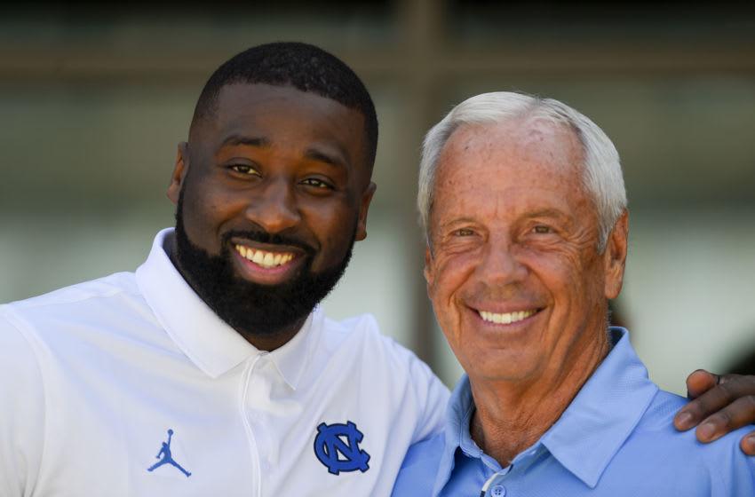 Sep 9, 2017; Chapel Hill, NC, USA; Former UNC Basketball player Raymond Felton and head coach Roy Williams before the game at Kenan Memorial Stadium. Mandatory Credit: Bob Donnan-USA TODAY Sports