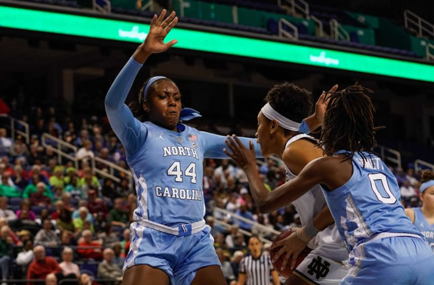 Mar 8, 2019; Greensboro , NC, USA; Notre Dame Fighting Irish center Mikayla Vaughn (30) gets trapped by North Carolina Tar Heels center Janelle Bailey (44) and guard Shayla Bennett (0) during the second half in the women's ACC Conference Tournament at Greensboro Coliseum. Mandatory Credit: Jim Dedmon-USA TODAY Sports