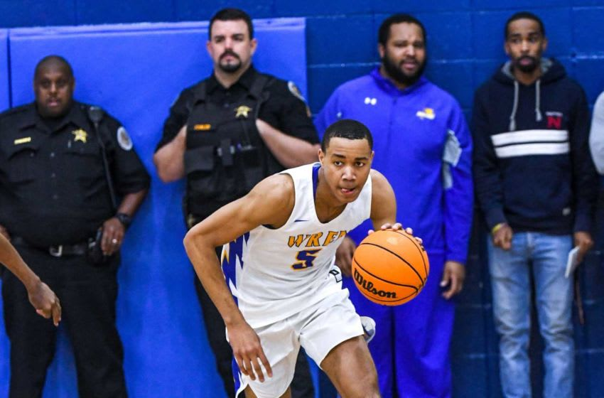 Wren junior Bryce McGowens(5) brings the ball up against Lower Richland during the fourth quarter of the Class AAAA playoff game at Wren High School in Piedmont Tuesday. Wren Vs Lower Richland Boys Basketball Class Aaaa Playoffs