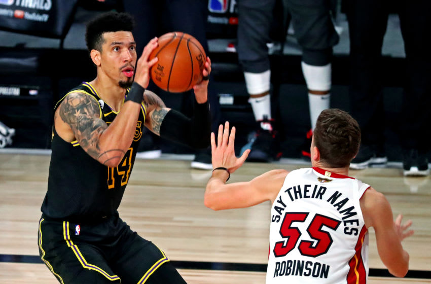 Oct 9, 2020; Lake Buena Vista, Florida, USA; Los Angeles Lakers guard Danny Green (14) shoots the ball against Miami Heat guard Duncan Robinson (55) during the third quarter in game five of the 2020 NBA Finals at AdventHealth Arena. Mandatory Credit: Kim Klement-USA TODAY Sports