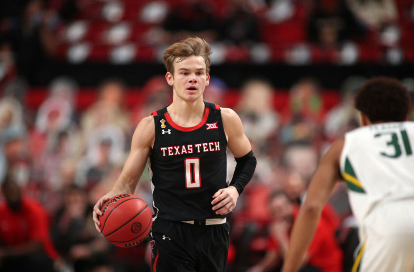 Jan 16, 2021; Lubbock, Texas, USA; Texas Tech Red Raiders guard Mac McClung (0) brings the ball up court against Baylor Bears guard MaCio Teague (31) in the first half at United Supermarkets Arena. Mandatory Credit: Michael C. Johnson-USA TODAY Sports
