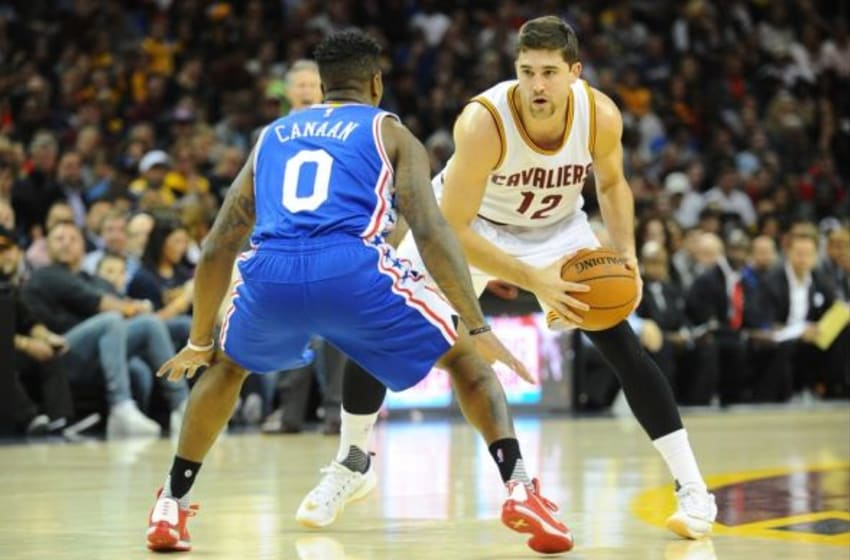 Nov 6, 2015; Cleveland, OH, USA; Cleveland Cavaliers guard Joe Harris (12) Philadelphia 76ers guard Isaiah Canaan (0) at Quicken Loans Arena. Mandatory Credit: Ken Blaze-USA TODAY Sports