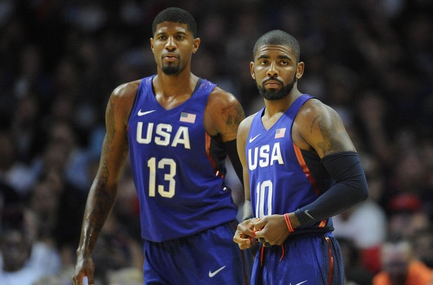 July 24, 2016; Los Angeles, CA, USA; USA guard Kyrie Irving (10) and forward Paul George (13) check in before playing against China in the first half during an exhibition basketball game at Staples Center. Mandatory Credit: Gary A. Vasquez-USA TODAY Sports