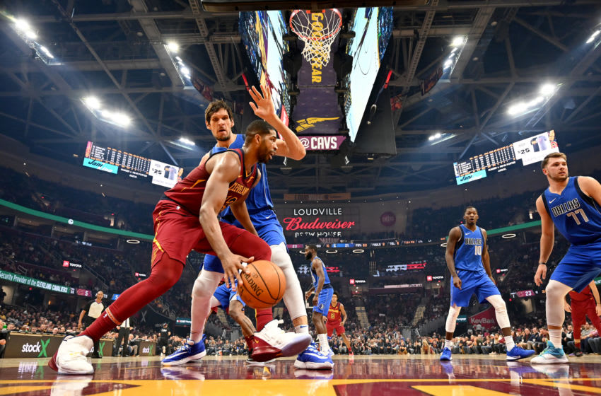 Cleveland Cavaliers big Tristan Thompson handles the ball against Dallas Mavericks big Boban Marjanovic. (Photo by Jason Miller/Getty Images)