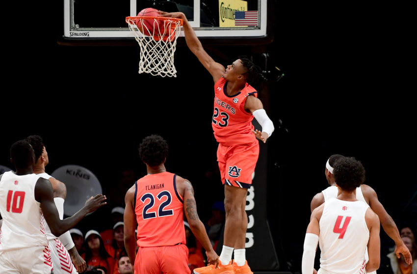 Auburn Tigers forward Isaac Okoro dunks the ball. (Photo by Emilee Chinn/Getty Images)