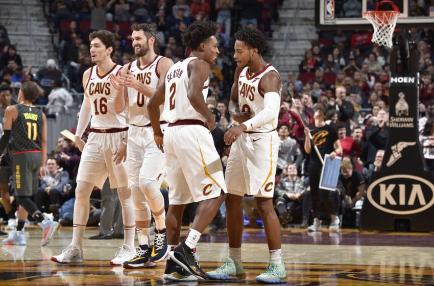Cleveland Cavaliers guards Darius Garland (far right) and Collin Sexton (third from the right) react in-game. (Photo by David Liam Kyle/NBAE via Getty Images)