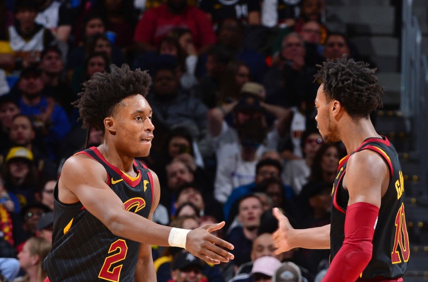 Cleveland Cavaliers guards Collin Sexton (left) and Darius Garland high-five. (Photo by Bart Young/NBAE via Getty Images)