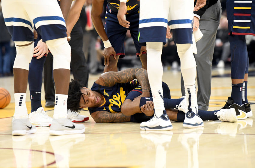 Cleveland Cavaliers wing Kevin Porter Jr. lies on the court after suffering an injury. (Photo by Jason Miller/Getty Images)