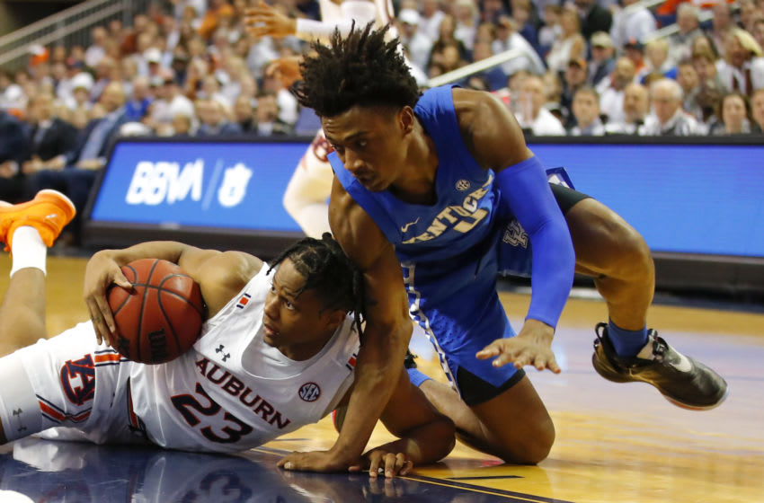 Auburn Tigers wing Isaac Okoro (#23) comes up with a loose ball. (Photo by Todd Kirkland/Getty Images)