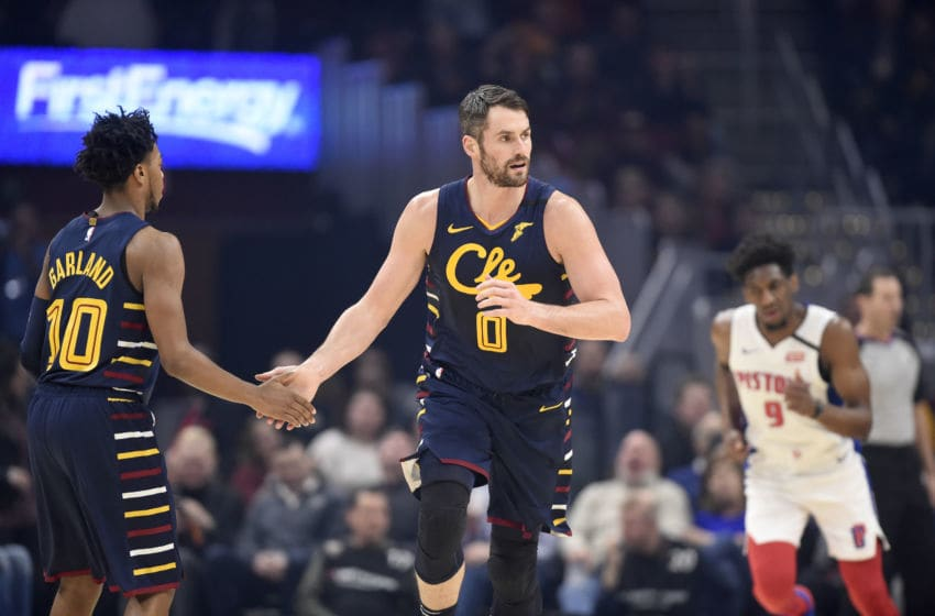 Cleveland Cavaliers guard Darius Garland (#10) celebrates with Cleveland big man Kevin Love (#0) in-game. (Photo by Jason Miller/Getty Images)