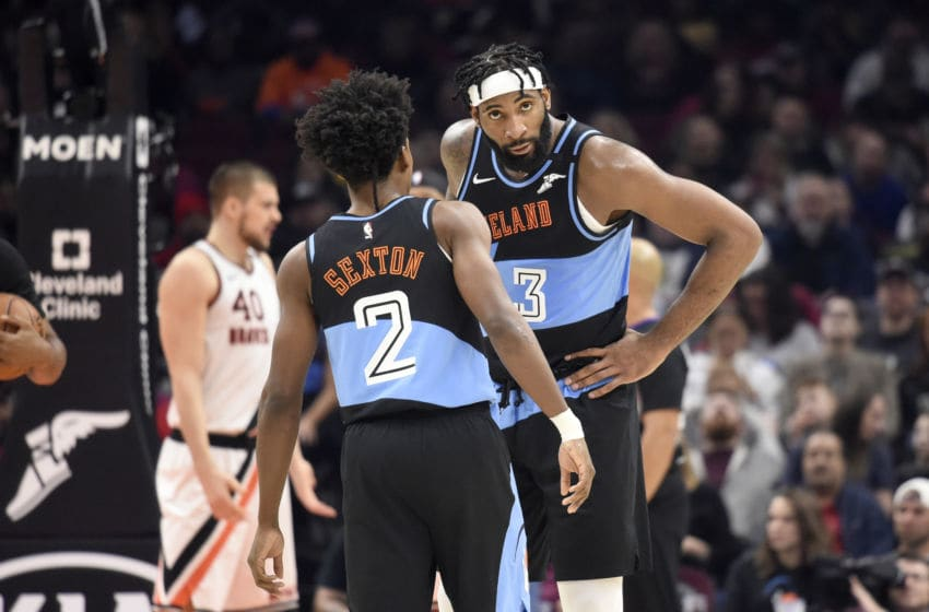 Cleveland Cavaliers guard Collin Sexton talks with Cleveland big man Andre Drummond in-game. (Photo by Jason Miller/Getty Images)