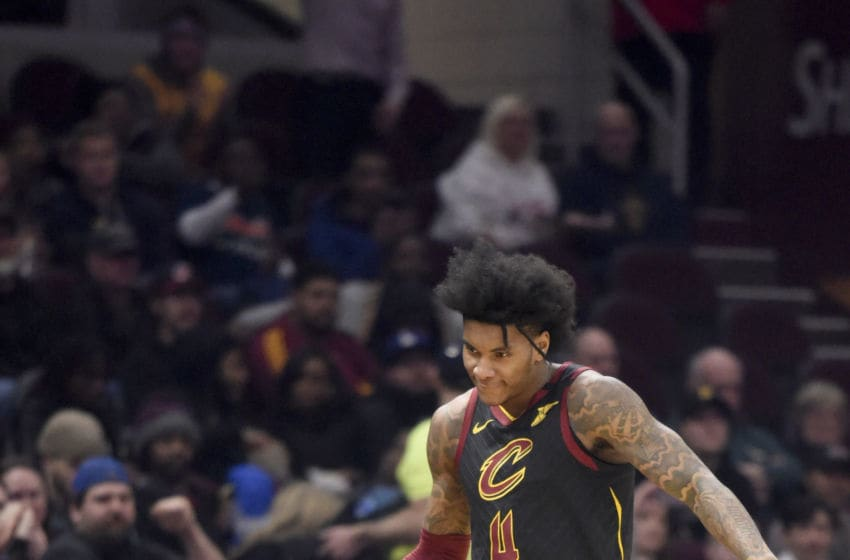 Cleveland Cavaliers wing Kevin Porter Jr. celebrates with fans after scoring. (Photo by Jason Miller/Getty Images)