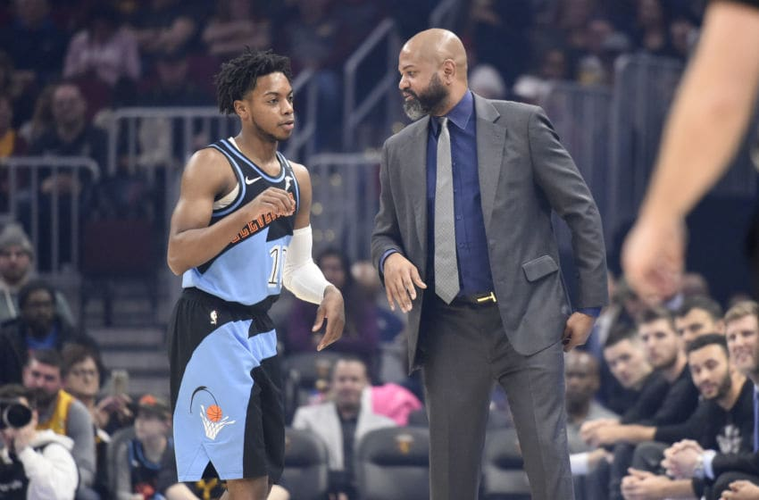 Cleveland Cavaliers head coach J.B. Bickerstaff talks with Cleveland guard Darius Garland. (Photo by Jason Miller/Getty Images)