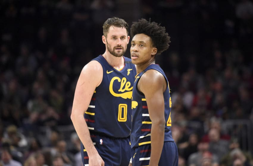 Cleveland Cavaliers big man Kevin Love and Cleveland guard Collin Sexton talk in-game. (Photo by Jason Miller/Getty Images)