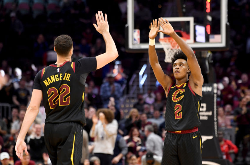 Cleveland Cavaliers big man Larry Nance Jr. high-fives Cleveland guard Collin Sexton in-game. (Photo by Jason Miller/Getty Images)