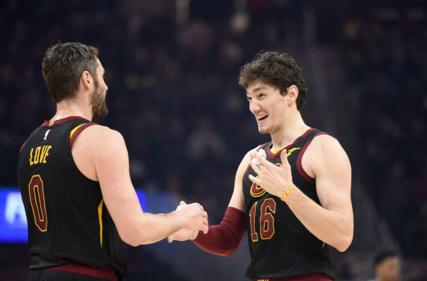Cleveland Cavaliers big man Kevin Love (left) and Cleveland wing Cedi Osman talk in-game. (Photo by Jason Miller/Getty Images)