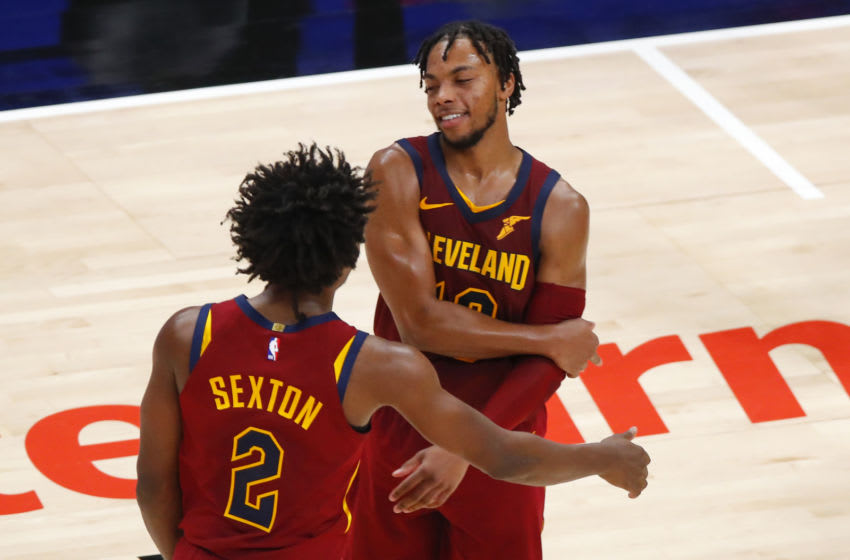 Cleveland Cavaliers guards Darius Garland (#10) and Collin Sexton (#2) react in-game. (Photo by Todd Kirkland/Getty Images)