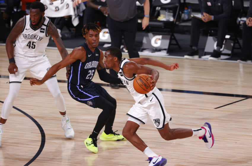 Guard Jeremiah Martin, then of the Brooklyn Nets, drives. (Photo by Mike Ehrmann/Getty Images)