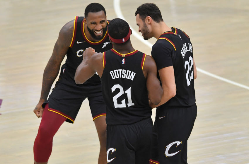 Cleveland Cavaliers bigs Andre Drummond (left) and Larry Nance Jr. (right) celebrate with Cleveland guard Damyean Dotson (middle) in-game. (Photo by Jason Miller/Getty Images)