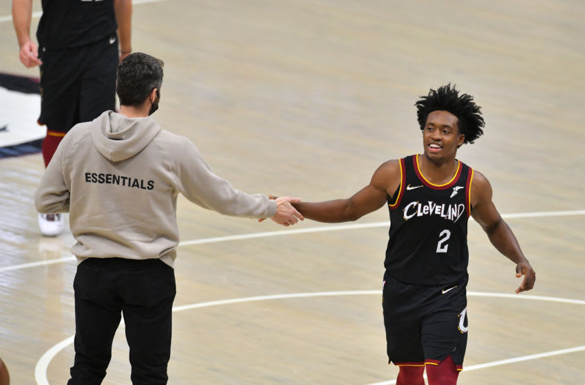 Cleveland Cavaliers big Kevin Love (left) celebrates with Cleveland guard Collin Sexton in-game. (Photo by Jason Miller/Getty Images)