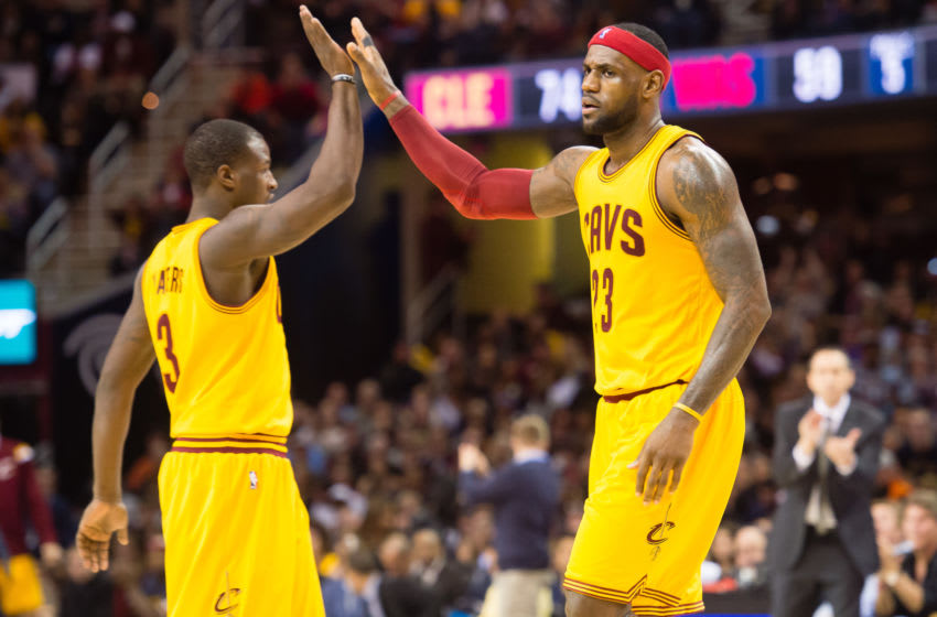 Cleveland Cavaliers guard Dion Waiters and Cleveland forward LeBron James celebrate in-game. (Photo by Jason Miller/Getty Images)