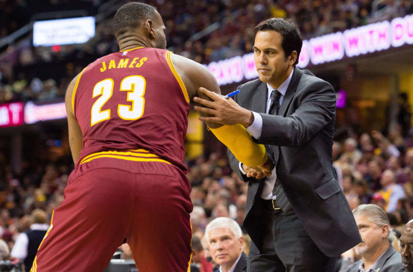 Cleveland Cavaliers forward LeBron James greets his former Miami Heat head coach, Erik Spoelstra. (Photo by Jason Miller/Getty Images)