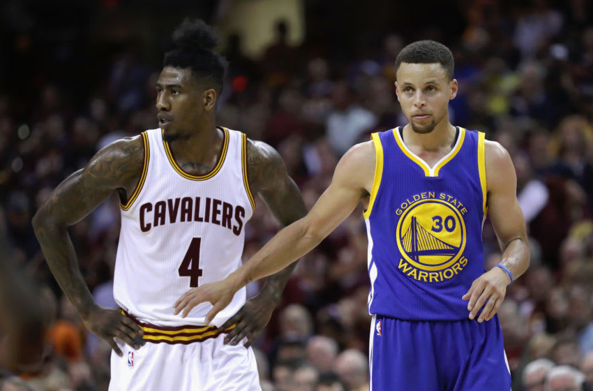 Then-guard Iman Shumpert (left) of the Cleveland Cavaliers looks on. (Photo by Ronald Martinez/Getty Images)