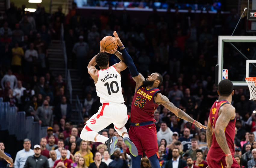 CLEVELAND, OH - MARCH 21: DeMar DeRozan #10 of the Toronto Raptors tries to take a last second shot over LeBron James #23 of the Cleveland Cavaliers during the second half at Quicken Loans Arena on March 21, 2018 in Cleveland, Ohio. The Cavaliers defeated the Raptors 132-129. NOTE TO USER: User expressly acknowledges and agrees that, by downloading and or using this photograph, User is consenting to the terms and conditions of the Getty Images License Agreement. (Photo by Jason Miller/Getty Images) *** Local Caption *** DeMar DeRozan; LeBron James