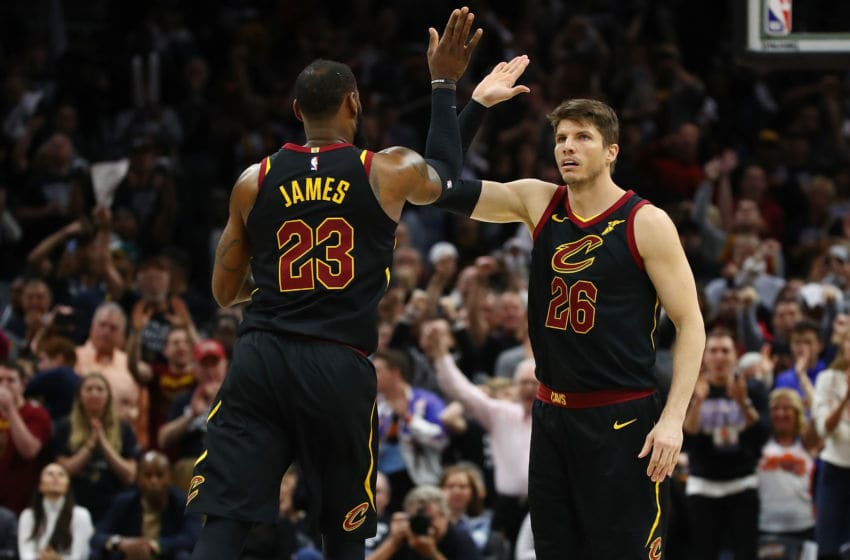 Cleveland Cavaliers forward LeBron James and Cleveland guard Kyle Korver celebrate in-game. (Photo by Gregory Shamus/Getty Images)