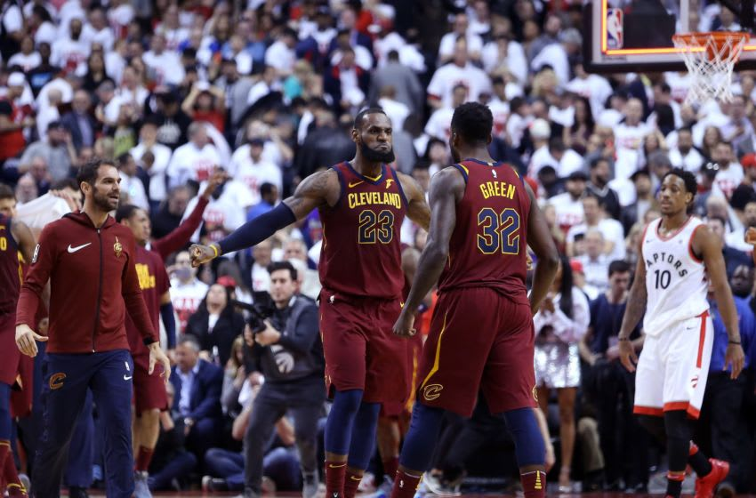 TORONTO, ON - MAY 01: LeBron James #23 of the Cleveland Cavaliers celebrates with Jeff Green #32 in overtime in Game One of the Eastern Conference Semifinals against the Toronto Raptors during the 2018 NBA Playoffs at Air Canada Centre on May 1, 2018 in Toronto, Canada. NOTE TO USER: User expressly acknowledges and agrees that, by downloading and or using this photograph, User is consenting to the terms and conditions of the Getty Images License Agreement. (Photo by Vaughn Ridley/Getty Images)