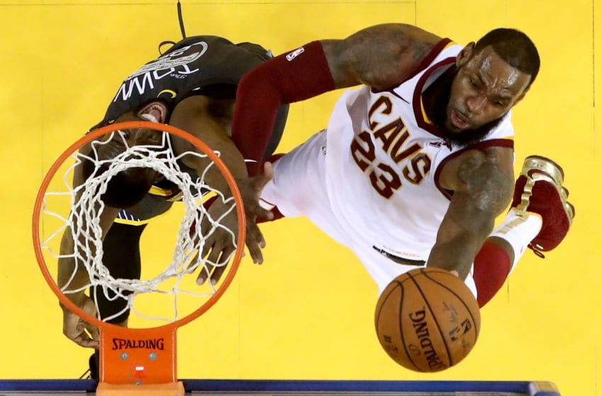 OAKLAND, CA - JUNE 03: LeBron James #23 of the Cleveland Cavaliers attempts a layup against Draymond Green #23 of the Golden State Warriors in Game 2 of the 2018 NBA Finals at ORACLE Arena on June 3, 2018 in Oakland, California. NOTE TO USER: User expressly acknowledges and agrees that, by downloading and or using this photograph, User is consenting to the terms and conditions of the Getty Images License Agreement. (Photo by Ezra Shaw/Getty Images)